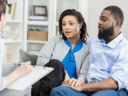 divorcing couple with mediator